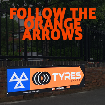 Follow The Orange Arrows - Directs people to the garage